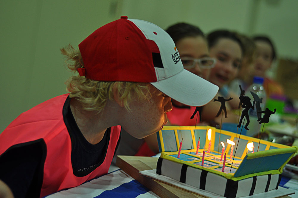 jump-street-birthday-party-kid-blowing-candle